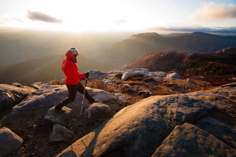 A woman hiking at sunset, Parc national des Grands-Jardins, Quebec